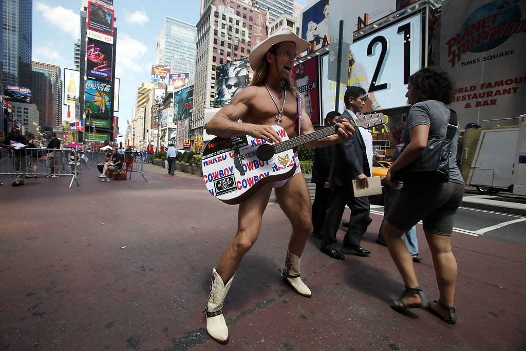 Naked cowboy still singing in times square