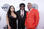 Jennifer Andrade, Nile Rodgers and Russell Peters attend We Are Family Foundation honors Dolly Parton & Jean Paul Gaultier at Hammerstein Ballroom on November 05, 2019 in New York City.