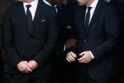 FIFA president Gianni Infantino (R) talks with the former player Clarence Seedorf (C) during the funeral of the members of the Chapecoense Real football club team killed in a plane crash in Colombia at the club's Arena Conda stadium in Chapeco, in the southern Brazilian state of Santa Catarina, on December 03, 2016. Players of the Chapecoense team were among the 77 people on board the doomed flight that crashed into mountains in northwestern Colombia. Officials said just six people were thought to have survived, including three of the players. Chapecoense had risen from obscurity to make it to the Copa Sudamericana finals scheduled for Wednesday against Atletico Nacional of Colombia.