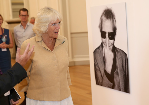 Camilla, Duchess of Cornwall looks at photographs in an exhibition by the photographer Rankin at the Fashion Festival in the Assembly Rooms on July 22, 2014 in Edinburgh, Scotland.