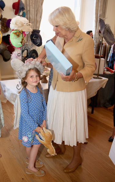 Camilla, Duchess of Cornwall meets seven year old Pickle Constance and her pet horse 'Pearl' as she browses stalls at the Fashion Festival in the Assembly Rooms on July 22, 2014 in Edinburgh, Scotland.
