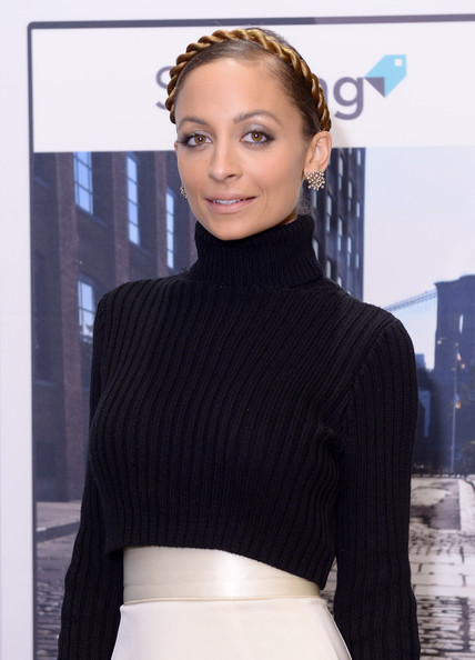 Fashion icon Nicole Richie poses at the launch of Styletag at Henri Bendel on December 6, 2013 in New York City.