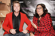 (L-R) Lance Bass and Fern Mallis attend Fashion's Night Out at Saks Fifth Avenue on September 6, 2012 in New York City.