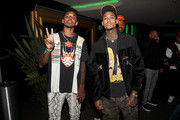 (L-R) Nick Young and Jordan Clarkson are seen as Fashion Nova Presents: Party With Cardi at Hollywood Palladium on May 8, 2019 in Los Angeles, California.