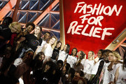 (L-R) Anna Cleveland, Maria Borges,Natalia Vodianova,Bella Hadid,Naomi Campbell,Heidi Klum,Natasha Poly and Tami Williams  pose on the runway at the Fashion for Relief event during the 70th annual Cannes Film Festival at Aeroport Cannes Mandelieu on May 21, 2017 in Cannes, France.