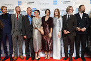 "(L-R) Joe Alwyn, Mark Gatiss, James Smith, Olivia Colman, Rachel Weisz, Emma Stone, Tony McNamara and Yorgos Lanthimos attend the UK Premiere of ""The Favourite"" & American Express Gala at the 62nd BFI London Film Festival on October 18, 2018 in London, England."