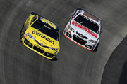 Matt Kenseth, driver of the #20 Dollar General Toyota, races Dale Earnhardt Jr., driver of the #88 National Guard Chevrolet, during the NASCAR Sprint Cup Series FedEx 400 Benefiting Autism Speaks at Dover International Speedway on June 1, 2014 in Dover, Delaware.