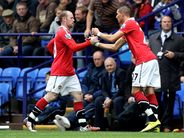 Federico Macheda Wayne Rooney of Manchester United is replaced by team mate Federico Macheda (R) during the Barclays Premier League match between Bolton Wanderers and Manchester United at the Reebok Stadium on September 26, 2010 in Bolton, England.