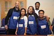 Common, Hannaha Hall, Tai Davis, Barton Fitzpatrick, and Shamon Brown Jr. volunteer at St Stephen AME Church in partnership with Feeding America, The Common Ground Foundation and Greater Chicago Food Depository on November 22, 2017 in Chicago, Illinois.