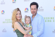 Jennifer Finnigan and Jonathan Silverman attend the Feeding Families and Building Communities: Heifer International Event with NBC at Universal Studios Backlot on October 21, 2018 in Universal City, California.