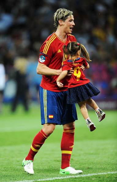 Fernando Torres Fernando Torres of Spain picks up his daughter Nora Torres after the UEFA EURO 2012 final match between Spain and Italy at the Olympic Stadium on July 1, 2012 in Kiev, Ukraine.