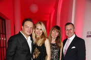 (L-R) Alexander zu Schaumburg-Lippe with wife Nadja Anna zu Schaumburg-Lippe, Maria S. Koteneva and Vladimir Kotenev attend the Festival Night by Bunte and BMW at Humboldt Carre on February 8, 2013 in Berlin, Germany.
