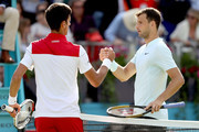 Novak Djokovic of Serbia is congratulated after his men's singles match by Grigor Dimitrov of Bulgaria during Day Four of the Fever-Tree Championships at Queens Club on June 21, 2018 in London, United Kingdom.