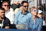 Jamie Redknapp wathces Novak Djokovic of Serbia during his men's singles match against Grigor Dimitrov of Bulgaria during Day Four of the Fever-Tree Championships at Queens Club on June 21, 2018 in London, United Kingdom.