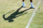 Novak Djokovic of Serbia bounces the ball before serving during the match against Grigor Dimitrov of Bulgaria during Day four of the Fever-Tree Championships at Queens Club on June 21, 2018 in London, United Kingdom.