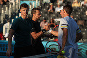 Jamie Murray of Great Britain and and Brazil's Bruno Soares look dejected after defeat to Henri Kontinen of Finald and Australia's John Peers during Day 7 of the Fever-Tree Championships at Queens Club on June 24, 2018 in London, United Kingdom.