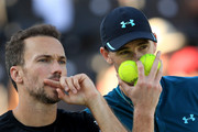 Jamie Murray of Great Britain and Brazil's Bruno Soares react during defeat to Henri Kontinen of Finald and Australia's John Peers during Day 7 of the Fever-Tree Championships at Queens Club on June 24, 2018 in London, United Kingdom.
