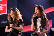 Ally Brooke Hernandez and Camila Cabello of Fifth Harmony speak on the Honda Stage at iHeartRadio Theater on February 5, 2015 in Burbank, California.