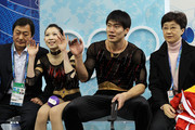 Dan Zhang and Hao Zhang of China reacts in the kiss and cry area after they competed in the figure skating pairs free skating on day 4 of the Vancouver 2010 Winter Olympics at the Pacific Coliseum on February 15, 2010 in Vancouver, Canada.