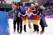 Gold medal winners Aljona Savchenko and Bruno Massot of Germany celebrate with their coaches during the victory ceremony after the Pair Skating Free Skating at Gangneung Ice Arena on February 15, 2018 in Gangneung, South Korea.