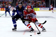Miro Heiskanen (L) of Finland and Mikkel Boedker of Denmark battle for the puck during the 2018 IIHF Ice Hockey World Championship group stage game between Finland and Denmark at Jyske Bank Boxen on May 9, 2018 in Herning, Denmark.
