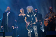 John Farnham (L) and Brian May of Queen (C) perform during Fire Fight Australia at ANZ Stadium on February 16, 2020 in Sydney, Australia.