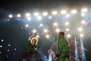Adam Lambert (R) performs with Brian May of Queen during Fire Fight Australia at ANZ Stadium on February 16, 2020 in Sydney, Australia.
