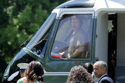 (L-R) U.S. first lady Michelle Obama, daughters Sasha Obama and Malia Obama, and President Barack Obama board Marine One on the South Lawn as they depart the White House June 17, 2016 in Washington, DC. The first family is traveling to New Mexico and tour Carlsbad Caverns National Park to celebrate the 100th anniversary of the creation of America's national park system.
