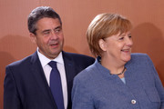 German Chancellor Angela Merkel and German Vice Chancellor and Foreign Minister Sigmar Gabriel arrive for the weekly cabinet meeting in Berlin on November 22, 2017. / AFP PHOTO / Adam BERRY