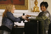"Music artist Melissa Etheridge (L) is congratulated by soul music icon Patti LaBelle after Etheridge performed the song ""Stormy Weather"" during a workshop titled ""I'm Every Woman: The History of Women in Soul"" in the State Dining Room at the White House March 6, 2014 in Washington, DC. As part of a concert honoring women in soul music, First Lady Michelle Obama hosted the workshop for 124 students from middle school, high school and colleges from across the country."