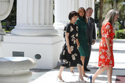 U.S. first lady Melania Trump and Japan's first lady Akie Abe are greeted by Erin Manning, executive director of the Flagler Museum, and William Matthews as they arrive for a tour of the Flagler museum on April 18, 2018 in Palm Beach, Florida. The first ladies accompanied their husbands U.S. President Donald Trump and Japan's Prime Minister Shinzo Abe to Palm Beach.