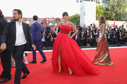 Eleonora Carisi walks the red carpet ahead of the opening ceremony and the 'First Man' screening during the 75th Venice Film Festival at Sala Grande on August 29, 2018 in Venice, Italy.