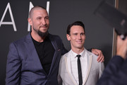 """Actors Pablo Schreiber and Cory Michael Smith attend the """"First Man"""" premiere at the National Air and Space Museum on October 4, 2018 in Washington, DC."""