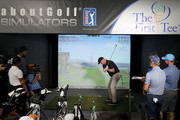 Boomer Esiason takes his turn at the golf simulator during The First Tee Experience At The Northern Trust at Ridgewood Country Club on August 21, 2018 in Paramus, New Jersey.