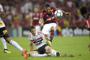 Paolo Guerrero (R) of Flamengo struggles for the ball with Anderson Martins of Sao Paulo during the match between Flamengo and Sao Paulo as part of Brasileirao Series A 2018 at Maracana Stadium on July 18, 2018 in Rio de Janeiro, Brazil.