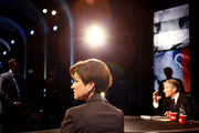 Gubernatorial candidate Alex Sink looks over the stage during her debate with Rick Scott on CNN as moderator John King (R) sits nearby October 25, 2010 at the University of South Florida in Tampa, Florida. Sink is currently the Chief Financial Officer for the state of Florida.