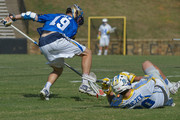 Kevin Drew #19 of the Charlotte Hounds battles Connor Buczek #20 of the Florida Launch for a ground ball during their game at American Legion Memorial Stadium on July 11, 2015 in Charlotte, North Carolina. Florida won 17-16 in overtime.