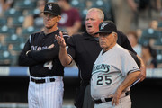 (L-R) Manager Jim Tracy #4 of the Colorado Rockies homeplate umpire Tim Welke and manager Jack McKeon #25 of the Florida Marlins review the ground rules prior to the game at Coors Field on August 15, 2011 in Denver, Colorado.