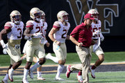 Head coach Jimbo Fisher of the Florida State Seminoles runs onto the field with his team against the Wake Forest Demon Deacons before their game at BB&T Field on September 30, 2017 in Winston Salem, North Carolina.