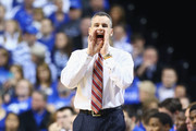 Billy Donovan the head coach of the Florida Gators gives instructions to his team during the game against the Kentucky Wildcats at Rupp Arena on February 15, 2014 in Lexington, Kentucky.