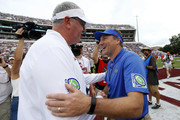 Head coach Joe Moorhead of the Mississippi State Bulldogs and head coach Dan Mullen of the Florida Gators greet each other before a game at Davis Wade Stadium on September 29, 2018 in Starkville, Mississippi.