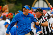 Head coach Dan Mullen of the Florida Gators is grabbed by an official during the first half of a game against the Vanderbilt Commodores at Vanderbilt Stadium on October 13, 2018 in Nashville, Tennessee.