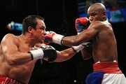 (L-R) Juan Manuel Marquez of Mexico and Floyd Mayweather Jr. exchange blows during their welterweight bout at the MGM Grand Garden Arena September 19, 2009 in Las Vegas, Nevada.