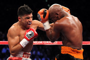 (L-R) Victor Ortiz throws a left to the head of Floyd Mayweather Jr. during their WBC welterweight title fight at the MGM Grand Garden Arena on September 17, 2011 in Las Vegas, Nevada.