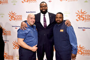 Former NFL player Chris Canty (C) and Food Bank For New York City employees attend the Food Bank for New York City's Can Do Awards Dinner at Cipriani Wall Street on April 17, 2018 in New York City.