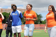 Food Bank For New York City kicks off EATWISE, it's summer nutrition awareness program for teens with NFL superstar and Food Bank ambassador Chris Canty at his Camp Of Champions, seen here with EATWISE teen ambassadors at George Washington High School Field on June 29, 2015 in New York City.