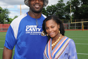 Food Bank For New York City kicks off EATWISE, it's summer nutrition awareness program for teens with NFL superstar and Food Bank ambassador Chris Canty at his Camp Of Champions, seen here with COO of Food Bank For New York City, Lisa Hines-Johnson .at George Washington High School Field on June 29, 2015 in New York City.