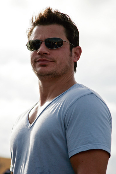 Actor Nick Lachey stands on the grid prior to the start of the NASCAR Sprint Cup Series Ford 400 at Homestead-Miami Speedway on November 22, 2009 in Homestead, Florida.