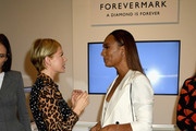 Actress Michelle Williams (L) and author Janet Mock speak Forevermark Diamonds Females In Focus Photo Exhibition Event on December 6, 2018 in New York City.