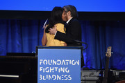 Honoree Goga Ashkenazi (L) and Bernard Henri Levy speak onstage during the Foundation Fighting Blindness World Gala at Cipriani 42nd Street on April 12, 2016 in New York City.